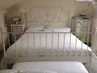 King size double bed 5 ft Wide with new mattress.