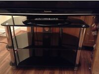 Black glass and chrome television TV stand