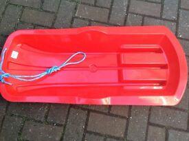 Child's snow sledge - red