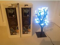 Miniature electric lighted trees. Xmas decorations or general use.