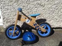 Apollo wooden balance bike and helmet.