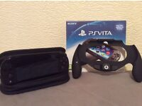 Ps vita, 2 8gb memory cards, carry case, original packaging and controller accessory