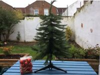 3.5 foot green Christmas Tree in great condition with red baubles