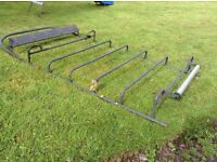 Van roof rack with roller to suit boat or ladders