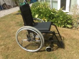 Quickie GP LIGHTWEIGHT wheelchair 18 stone capacity. Wheels simply remove, and the back folds down.