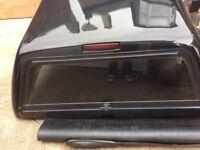 Black Nissan navara snug canopy