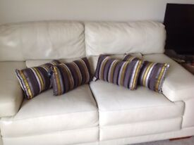 Four new and unused cushions