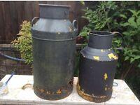 2 very old,very rusty milk churns