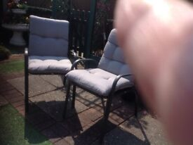 Set of 4lovely garden chairs,with thick padded cushions.never ever used.