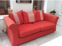 Three seater Sofa in red .75inches width ,height30inches ,depth 36inches ,good condition £80
