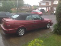 Saab 93 Convertible 1 years MOT Red cream leather interior no rips or tears 2.0 litre Automatic.
