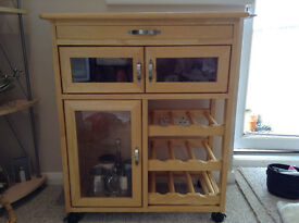wine trolley, with table surface, storage cupboards and drawer