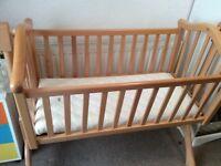 Wooden Mamas and papas swinging crib and mattress