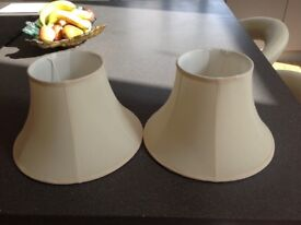Two cream lampshades