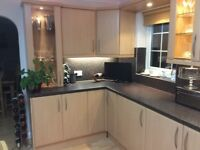 Beach effect kitchen units, work tops and appliances