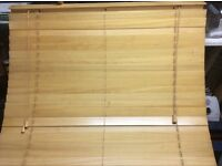 Two wood wide slat blinds