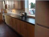 Complete set of kitchen units (Beech) and worktops.