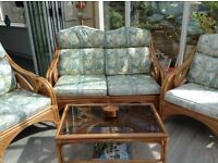 Cane 3-piece Suite with matching glass top coffee table for sale