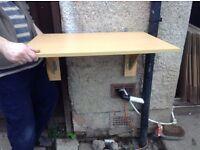 Folding wall table