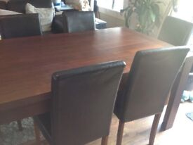 Walnut dining table and 6 faux leather chairs