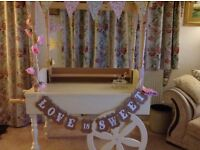 Beautiful classic cream candy cart to hire with jars and scoops from £35.
