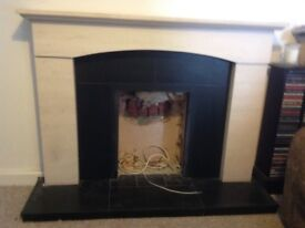 Cream Limestone Fireplace with black hearth and inserts