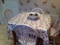 Table and four painted chairs for sale