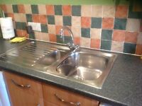 Kitchen sink 1.5 with taps in stainless steel in good condition