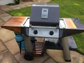 Outback 2 burner gas BBQ with roasting hood and side shelves