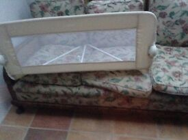 Tomy Bed Guard. Cream colour. Used twice. In very good condition.