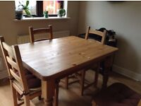 Solid pine table with drawer and four chairs
