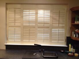 Two bifold ivory faux wooden plantation shutters 1770mm (W) X 1500mm (H)