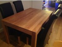 Solid oak dining table 135cm - 90cm and 4 scroll back black chairs
