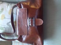 Collection of designer leather handbags