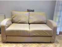 Sofa bed and foot stool, bed is on a frame