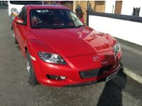 2004 Red Mazda RX8 sports coupe. Great drive!!