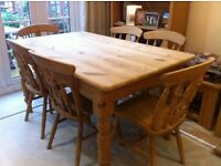 Pine farmhouse table and six chairs