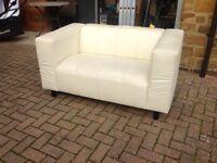 Small cream leather effect sofa