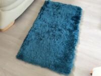 Brand new teal soft sheen piled rug.