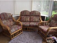 Conservatory cane three piece suite two seater and two chairs.