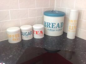 Tea coffee sugar and bread and pasta containers
