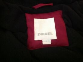 Nearly new girls Diesel jacket cost £219. Age 10.