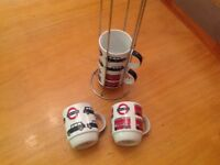 Coffee mugs on a stand, taxi & bus