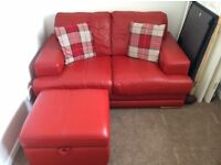 2 seater red leather sofa and foot stool with storage