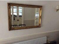 Guilt framed antique bevelled mirror