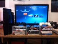 PS3 CONSOLE, 2 CONTROLLERS AND 20 GAMES