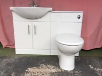 White sink and toilet Vanity Unit slight damage on wood top. Crome taps