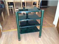 Unusual green metal and glass shelf unit.