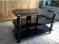 Large black glass TV stand , good condition £10