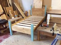 Solid wood single bed.